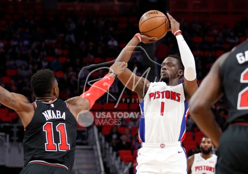 Mar 24, 2018; Detroit, MI, USA; Detroit Pistons guard Reggie Jackson (1) takes a shot against Chicago Bulls forward David Nwaba (11) during the second quarter at Little Caesars Arena. Mandatory Credit: Raj Mehta-USA TODAY Sports