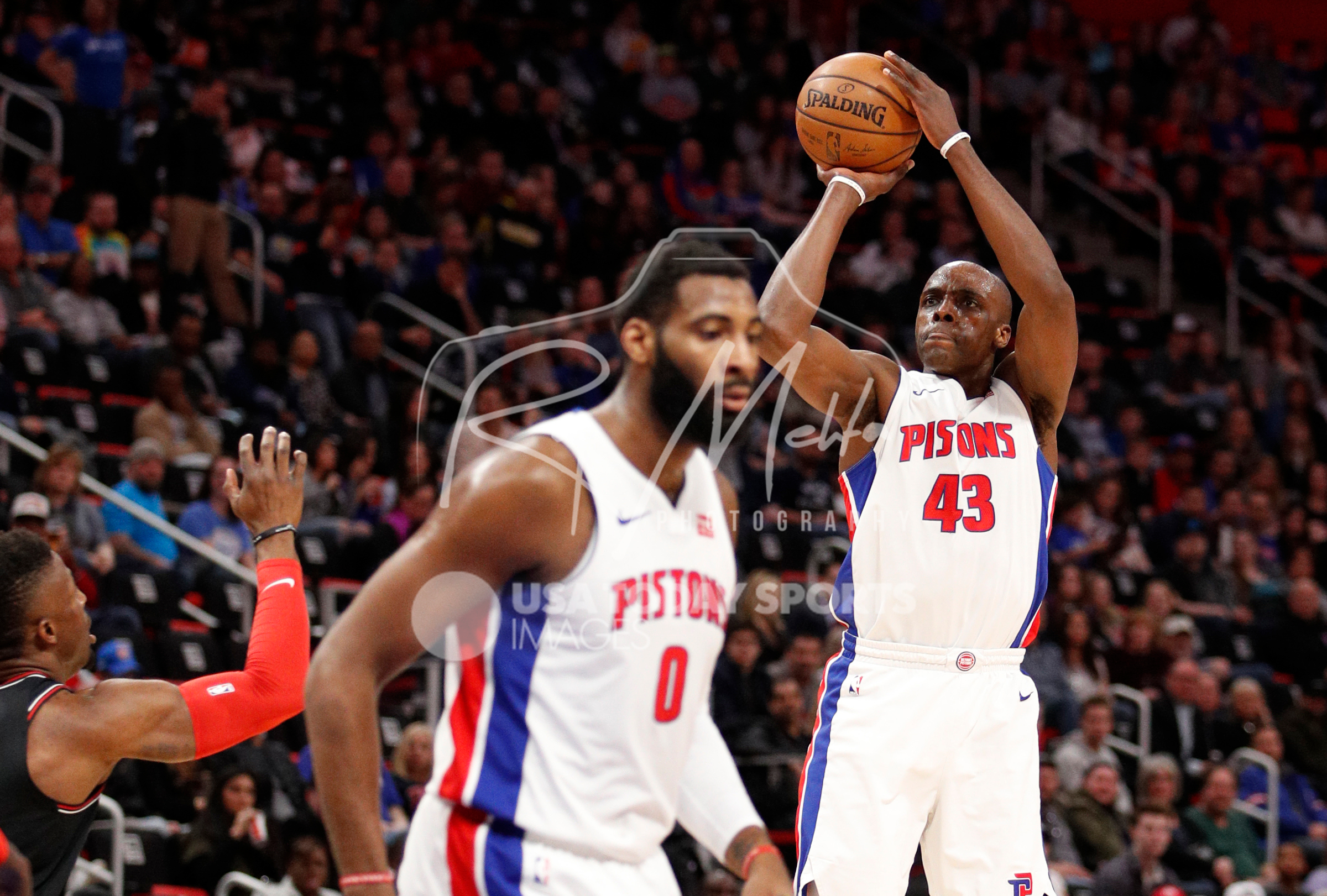 Mar 24, 2018; Detroit, MI, USA; Detroit Pistons forward Anthony Tolliver (43) takes a shot over Chicago Bulls forward David Nwaba (11) during the second quarter at Little Caesars Arena. Mandatory Credit: Raj Mehta-USA TODAY Sports