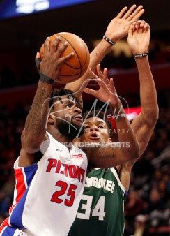 Feb 28, 2018; Detroit, MI, USA; Detroit Pistons forward Reggie Bullock (25) goes up for a shot against Milwaukee Bucks forward Giannis Antetokounmpo (34) during the first quarter at Little Caesars Arena. Mandatory Credit: Raj Mehta-USA TODAY Sports