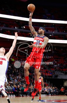 Mar 29, 2018; Detroit, MI, USA; Washington Wizards forward Mike Scott (30) takes a shot over Detroit Pistons forward Henry Ellenson (8) during the second quarter at Little Caesars Arena. Mandatory Credit: Raj Mehta-USA TODAY Sports