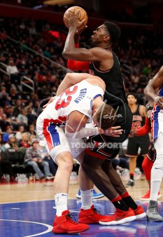 Mar 24, 2018; Detroit, MI, USA; Chicago Bulls forward Bobby Portis (5) commits a foul against Detroit Pistons forward Blake Griffin (23) during the third quarter at Little Caesars Arena. Mandatory Credit: Raj Mehta-USA TODAY Sports