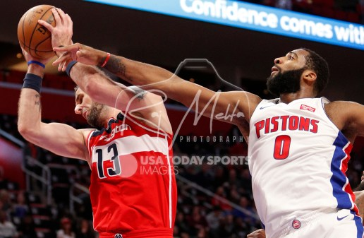 Mar 29, 2018; Detroit, MI, USA; Washington Wizards center Marcin Gortat (13) gets control of the ball against Detroit Pistons center Andre Drummond (0) during the third quarter at Little Caesars Arena. Mandatory Credit: Raj Mehta-USA TODAY Sports