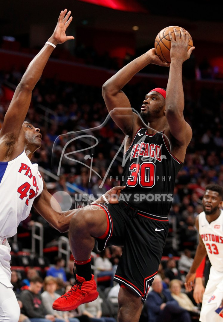 Mar 24, 2018; Detroit, MI, USA; Chicago Bulls forward Noah Vonleh (30) takes a shot over Detroit Pistons forward Anthony Tolliver (43) during the fourth quarter at Little Caesars Arena. Mandatory Credit: Raj Mehta-USA TODAY Sports
