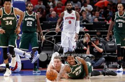 Feb 28, 2018; Detroit, MI, USA; Milwaukee Bucks guard Sterling Brown (23) and Detroit Pistons forward Blake Griffin (23) dive for the loose ball during the third quarter at Little Caesars Arena. Mandatory Credit: Raj Mehta-USA TODAY Sports