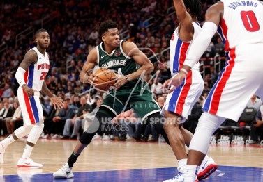 Feb 28, 2018; Detroit, MI, USA; Milwaukee Bucks forward Giannis Antetokounmpo (34) gets defended by Detroit Pistons forward Stanley Johnson (7) during the third quarter at Little Caesars Arena. Mandatory Credit: Raj Mehta-USA TODAY Sports
