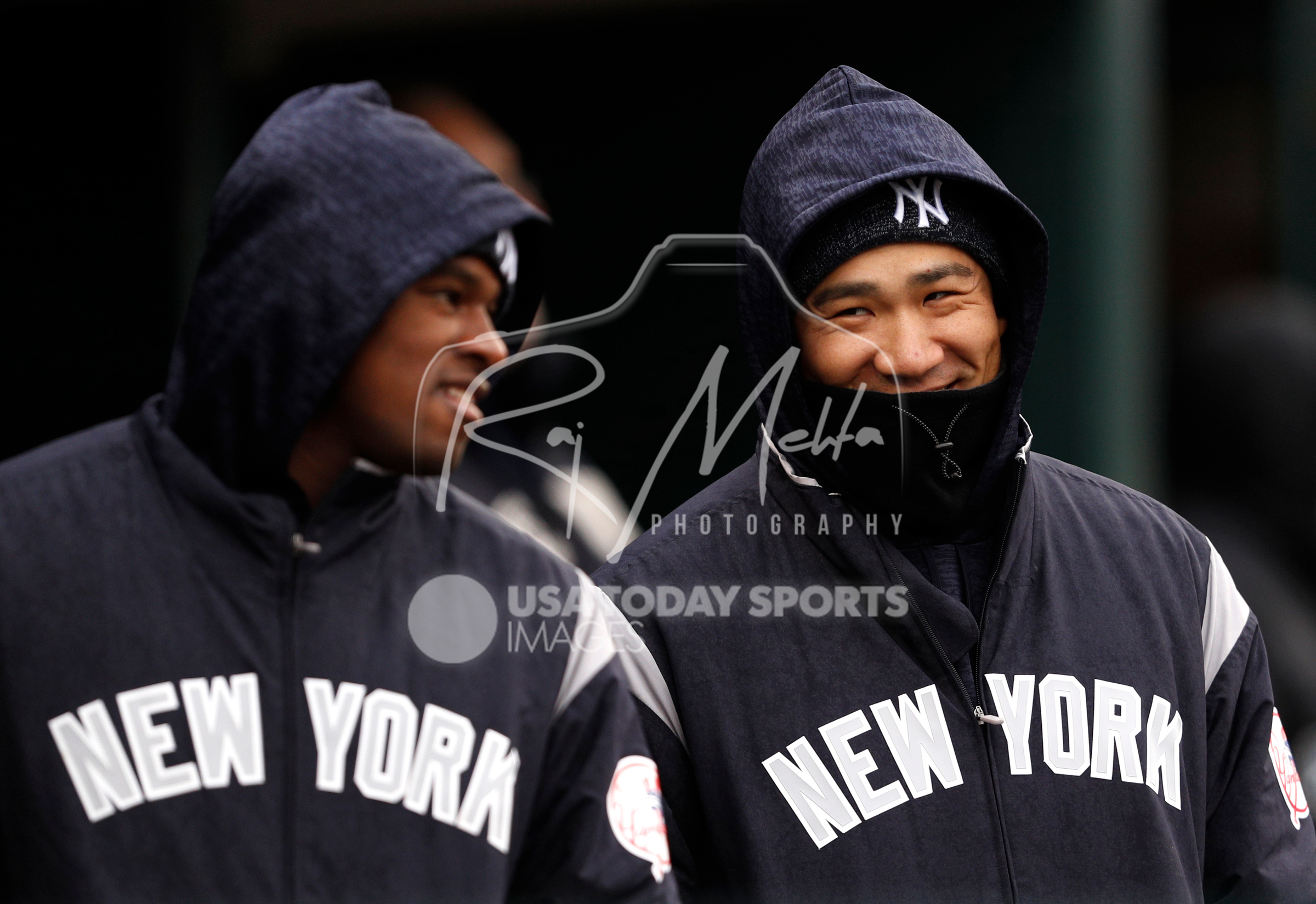 Apr 13, 2018; Detroit, MI, USA; New York Yankees starting pitcher Masahiro Tanaka (right) smiles in the dugout before the game against the Detroit Tigers at Comerica Park. Mandatory Credit: Raj Mehta-USA TODAY Sports