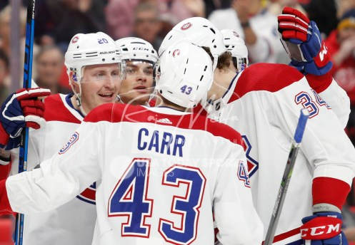 Apr 5, 2018; Detroit, MI, USA; Montreal Canadiens left wing Nicolas Deslauriers (20) celebrates with teammates after scoring a goal during the first period against the Detroit Red Wings at Little Caesars Arena. Mandatory Credit: Raj Mehta-USA TODAY Sports