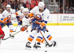 Apr 7, 2018; Detroit, MI, USA; New York Islanders right wing Chris Wagner (21) skates behind left wing Andrew Ladd (16) during the first period against the Detroit Red Wings at Little Caesars Arena. Mandatory Credit: Raj Mehta-USA TODAY Sports