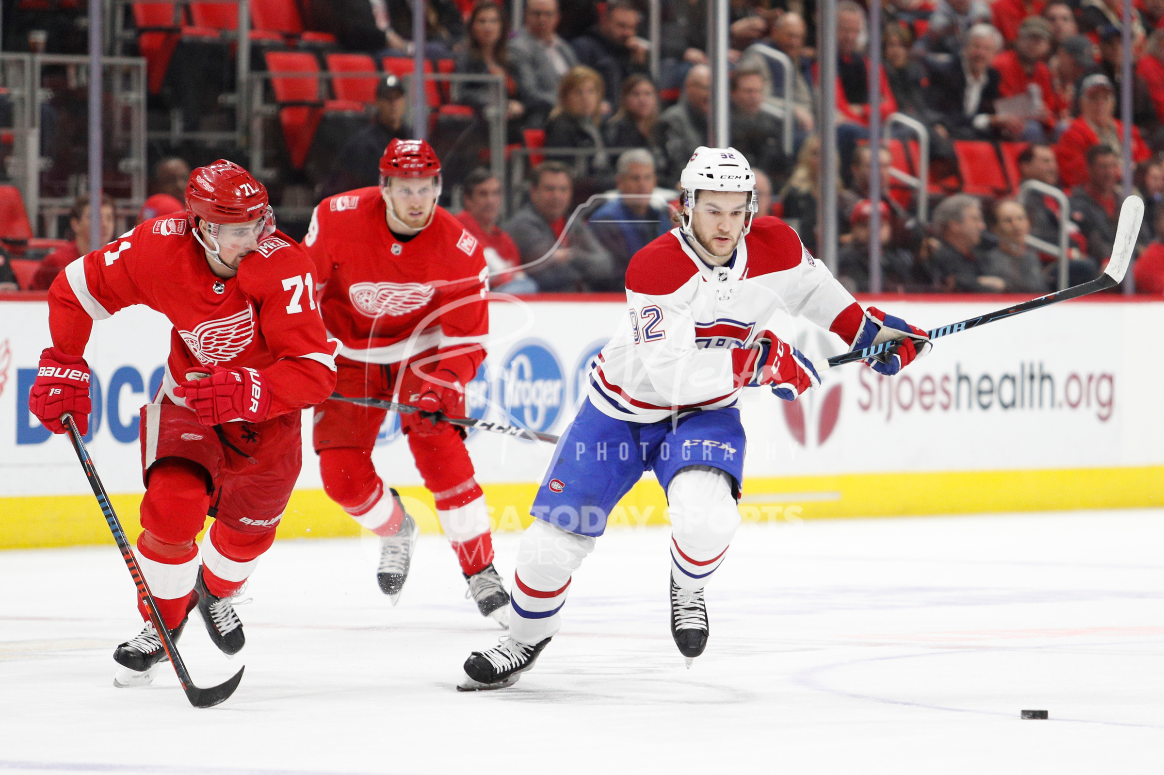Apr 5, 2018; Detroit, MI, USA; Montreal Canadiens center Jonathan Drouin (92) and Detroit Red Wings center Dylan Larkin (71) skate toward the puck during the first period at Little Caesars Arena. Mandatory Credit: Raj Mehta-USA TODAY Sports