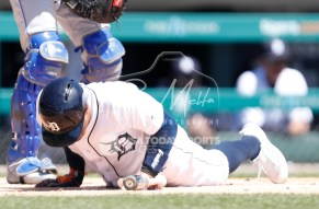 Apr 22, 2018; Detroit, MI, USA; Detroit Tigers center fielder Leonys Martin (12) goes down after getting hit by a pitch from Kansas City Royals starting pitcher Eric Skoglund (not pictured) during the first inning at Comerica Park. Mandatory Credit: Raj Mehta-USA TODAY Sports