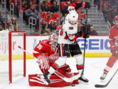 Mar 31, 2018; Detroit, MI, USA; Ottawa Senators center Colin White (36) tries to screen Detroit Red Wings goaltender Jimmy Howard (35) during the first period at Little Caesars Arena. Mandatory Credit: Raj Mehta-USA TODAY Sports