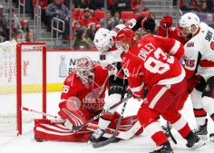 Mar 31, 2018; Detroit, MI, USA; Detroit Red Wings goaltender Jimmy Howard (35) makes a save against Ottawa Senators center Colin White (36) during the first period at Little Caesars Arena. Mandatory Credit: Raj Mehta-USA TODAY Sports