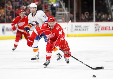 Apr 7, 2018; Detroit, MI, USA; Detroit Red Wings right wing Luke Glendening (41) skates to the puck in front of New York Islanders right wing Josh Bailey (12) during the second period at Little Caesars Arena. Mandatory Credit: Raj Mehta-USA TODAY Sports