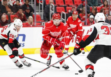 Mar 31, 2018; Detroit, MI, USA; Detroit Red Wings center Dylan Larkin (71) skates with the puck between Ottawa Senators left wing Magnus Paajarvi (56) and center Colin White (36) during the second period at Little Caesars Arena. Mandatory Credit: Raj Mehta-USA TODAY Sports