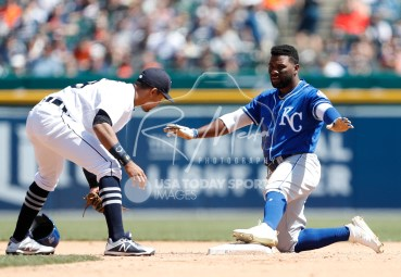 Apr 22, 2018; Detroit, MI, USA; Kansas City Royals right fielder Abraham Almonte (45) signals safe after stealing second base against Detroit Tigers shortstop Dixon Machado (49) during the fifth inning at Comerica Park. Mandatory Credit: Raj Mehta-USA TODAY Sports