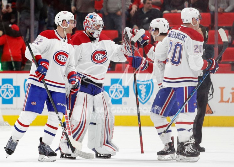 Apr 5, 2018; Detroit, MI, USA; Montreal Canadiens goaltender Antti Niemi (37) celebrates with left wing Charles Hudon (54) after the game against the Detroit Red Wings at Little Caesars Arena. Mandatory Credit: Raj Mehta-USA TODAY Sports