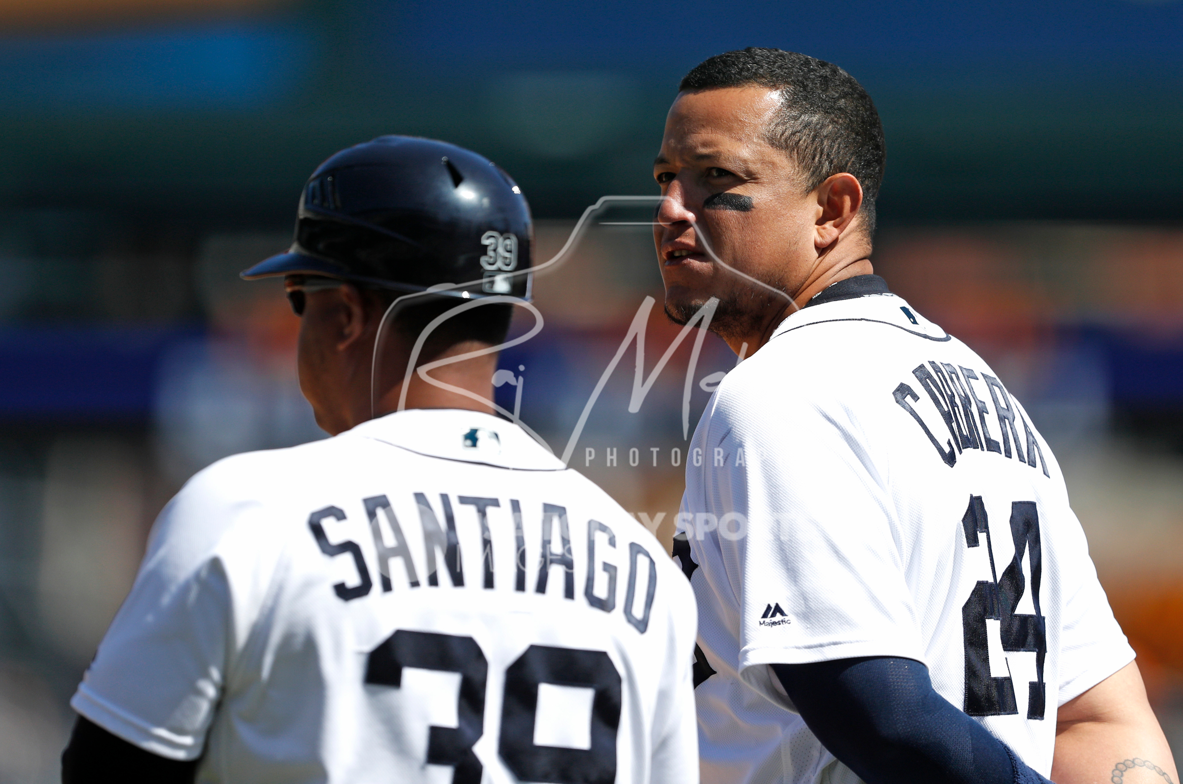 Apr 22, 2018; Detroit, MI, USA; Detroit Tigers first baseman Miguel Cabrera (24) standing next to first base coach Ramon Santiago (39) during the sixth inning against the Kansas City Royals at Comerica Park. Mandatory Credit: Raj Mehta-USA TODAY Sports