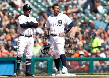 Apr 22, 2018; Detroit, MI, USA; Detroit Tigers first baseman Miguel Cabrera (24) stands next to third base coach Dave Clark (25) during the sixth inning against the Kansas City Royals at Comerica Park. Mandatory Credit: Raj Mehta-USA TODAY Sports