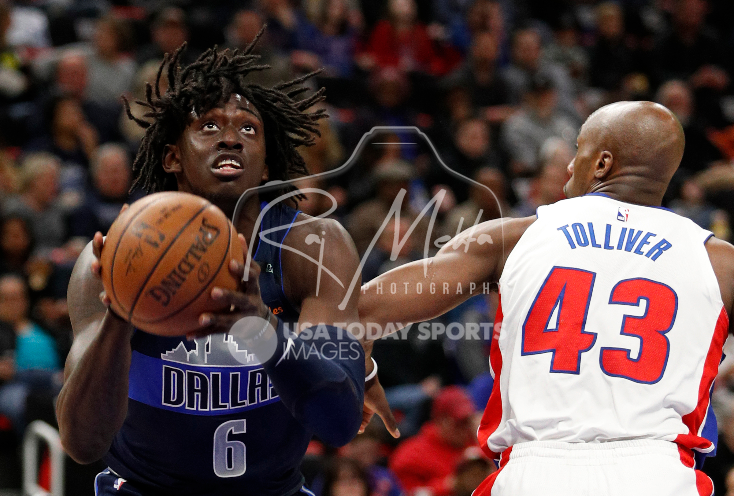 Apr 6, 2018; Detroit, MI, USA; Dallas Mavericks forward Johnathan Motley (6) goes up for a shot against Detroit Pistons forward Anthony Tolliver (43) during the first quarter at Little Caesars Arena. Mandatory Credit: Raj Mehta-USA TODAY Sports