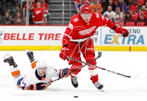 Apr 7, 2018; Detroit, MI, USA; New York Islanders defenseman Thomas Hickey (14) dives to defend Detroit Red Wings right wing Anthony Mantha (39) during overtime at Little Caesars Arena. Mandatory Credit: Raj Mehta-USA TODAY Sports