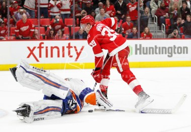 Apr 7, 2018; Detroit, MI, USA; New York Islanders goaltender Thomas Greiss (1) makes a save against Detroit Red Wings right wing Anthony Mantha (39) during overtime at Little Caesars Arena. Mandatory Credit: Raj Mehta-USA TODAY Sports