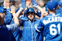 Apr 22, 2018; Detroit, MI, USA; Kansas City Royals third baseman Mike Moustakas (8) celebrates in the dugout with teammates after hitting a three run home run during the seventh inning against the Detroit Tigers at Comerica Park. Mandatory Credit: Raj Mehta-USA TODAY Sports