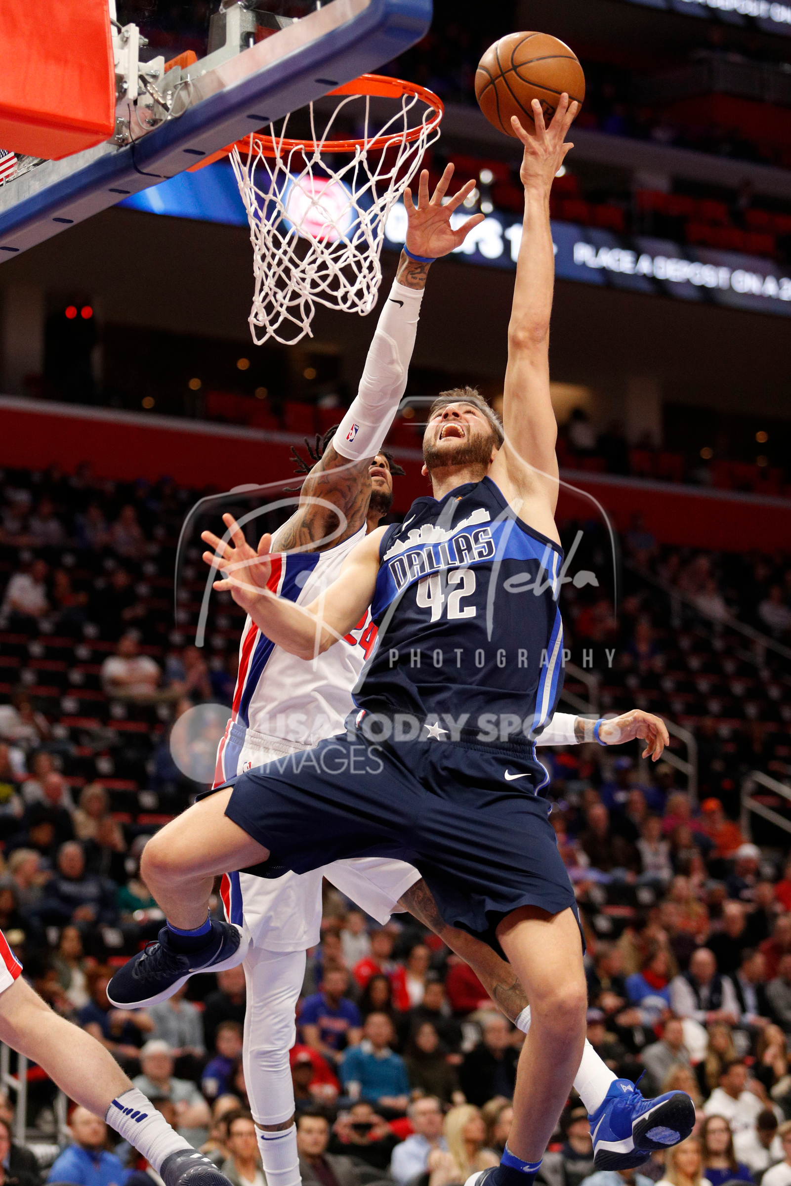 Apr 6, 2018; Detroit, MI, USA; Dallas Mavericks forward Maximilian Kleber (42) goes up for a shot against Detroit Pistons forward Eric Moreland (24) during the second quarter at Little Caesars Arena. Mandatory Credit: Raj Mehta-USA TODAY Sports