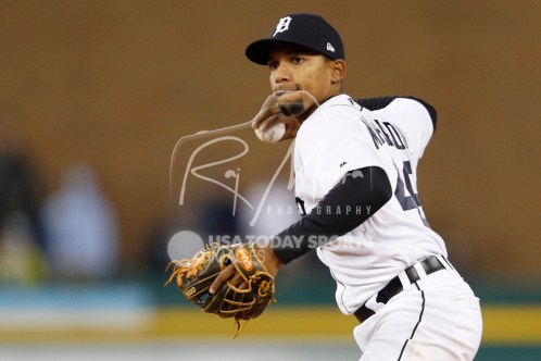 Apr 13, 2018; Detroit, MI, USA; Detroit Tigers shortstop Dixon Machado (49) throws the ball to first base for an out during the ninth inning against the New York Yankees at Comerica Park. Mandatory Credit: Raj Mehta-USA TODAY Sports