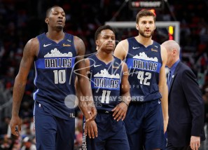 Apr 6, 2018; Detroit, MI, USA; Dallas Mavericks forward Dorian Finney-Smith (10) walks to the bench with guard Yogi Ferrell (11) and forward Maximilian Kleber (42) during the fourth quarter against the Detroit Pistons at Little Caesars Arena. Mandatory Credit: Raj Mehta-USA TODAY Sports