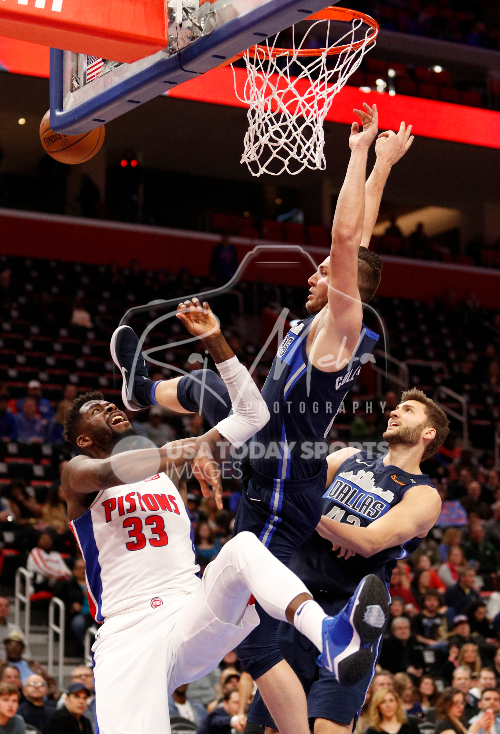 Apr 6, 2018; Detroit, MI, USA; Dallas Mavericks guard Kyle Collinsworth (8) collides with Detroit Pistons forward James Ennis III (33) during the fourth quarter at Little Caesars Arena. Mandatory Credit: Raj Mehta-USA TODAY Sports