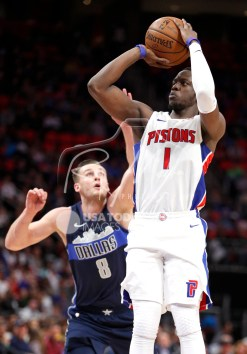 Apr 6, 2018; Detroit, MI, USA; Detroit Pistons guard Reggie Jackson (1) takes a shot against Dallas Mavericks guard Kyle Collinsworth (8) during the fourth quarter at Little Caesars Arena. Mandatory Credit: Raj Mehta-USA TODAY Sports