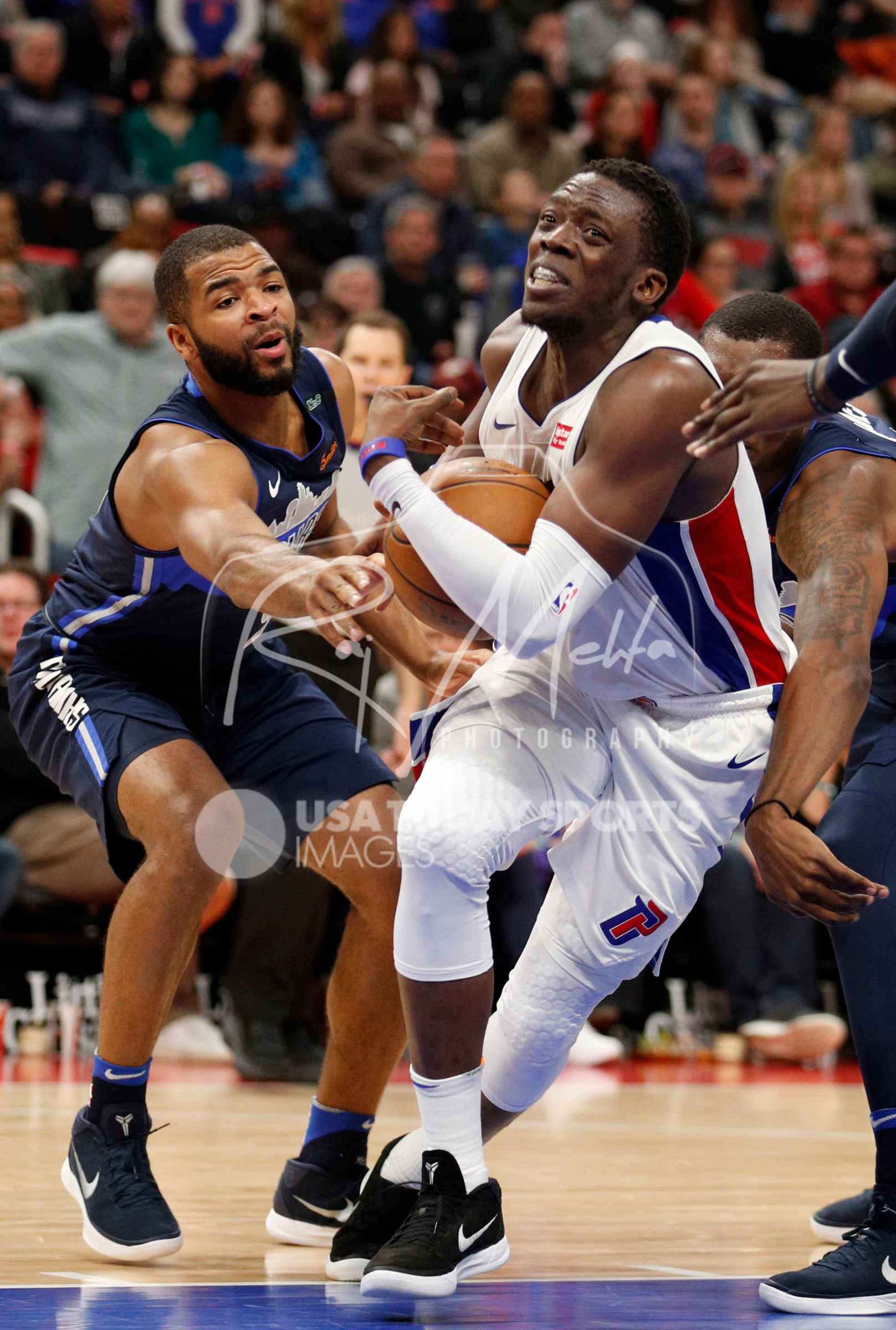 Apr 6, 2018; Detroit, MI, USA; Detroit Pistons guard Reggie Jackson (1) gets defended by Dallas Mavericks guard Aaron Harrison (9) during the fourth quarter at Little Caesars Arena. Mandatory Credit: Raj Mehta-USA TODAY Sports