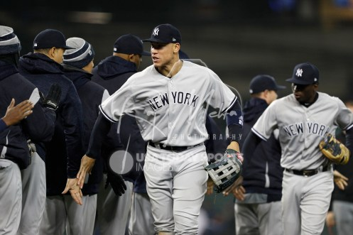 Apr 13, 2018; Detroit, MI, USA; New York Yankees right fielder Aaron Judge (99) celebrates with teammates after the game against the Detroit Tigers at Comerica Park. Mandatory Credit: Raj Mehta-USA TODAY Sports