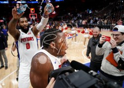 Apr 6, 2018; Detroit, MI, USA; Detroit Pistons center Andre Drummond (0) pours water on guard Reggie Jackson (1) after the game against the Dallas Mavericks at Little Caesars Arena. Mandatory Credit: Raj Mehta-USA TODAY Sports