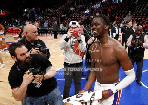 Apr 6, 2018; Detroit, MI, USA; Detroit Pistons guard Reggie Jackson (1) walks on the court without a shirt after getting doused with water after the game against the Dallas Mavericks at Little Caesars Arena. Mandatory Credit: Raj Mehta-USA TODAY Sports