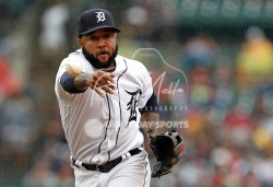 Jul 22, 2018; Detroit, MI, USA; Detroit Tigers third baseman Ronny Rodriguez (60) tosses the ball to first base during the second inning against the Boston Red Sox at Comerica Park. Mandatory Credit: Raj Mehta-USA TODAY Sports