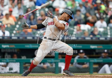Jul 22, 2018; Detroit, MI, USA; Boston Red Sox shortstop Xander Bogaerts (2) lets go of his bat and dodges away from a high pitch from Detroit Tigers starting pitcher Drew VerHagen (not pictured) during the sixth inning at Comerica Park. Mandatory Credit: Raj Mehta-USA TODAY Sports