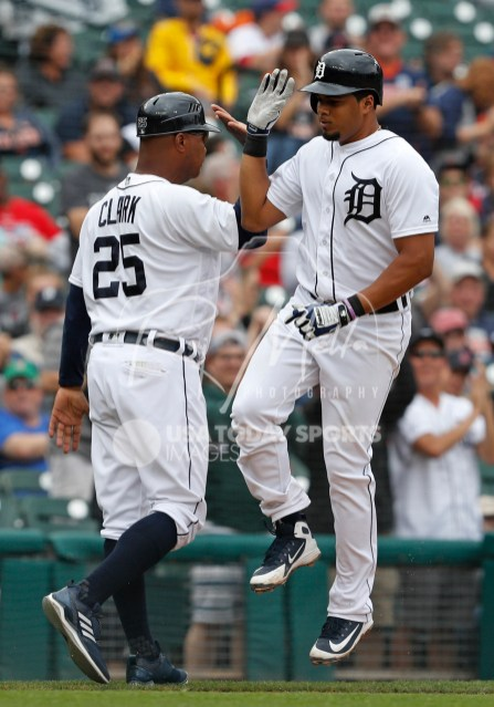 Jul 22, 2018; Detroit, MI, USA; Detroit Tigers third baseman Jeimer Candelario (46) gives a jumping high five to third base coach Dave Clark (25) after hitting solo home run during the seventh inning against the Boston Red Sox at Comerica Park. Mandatory Credit: Raj Mehta-USA TODAY Sports