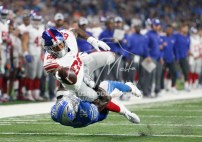 Aug 17, 2018; Detroit, MI, USA; New York Giants tight end Evan Engram (88) reaches for extra yardage after a catch during the first quarter against Detroit Lions defensive back Tavon Wilson (32) at Ford Field. Mandatory Credit: Raj Mehta-USA TODAY Sports