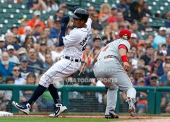 Aug 1, 2018; Detroit, MI, USA; Detroit Tigers third baseman Jeimer Candelario (46) avoids getting tagged by Cincinnati Reds third baseman Eugenio Suarez (7) during the second inning at Comerica Park. Mandatory Credit: Raj Mehta-USA TODAY Sports