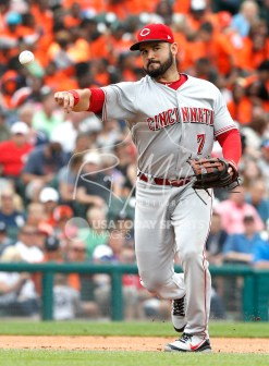 Aug 1, 2018; Detroit, MI, USA; Cincinnati Reds third baseman Eugenio Suarez (7) makes a throw to first base for an out during the fifth inning against the Detroit Tigers at Comerica Park. Mandatory Credit: Raj Mehta-USA TODAY Sports