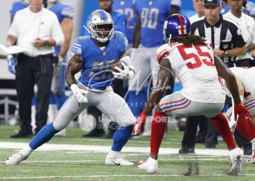 Aug 17, 2018; Detroit, MI, USA; Detroit Lions running back Theo Riddick (25) runs with the ball against New York Giants linebacker Ray-Ray Armstrong (55) during the second quarter at Ford Field. Mandatory Credit: Raj Mehta-USA TODAY Sports