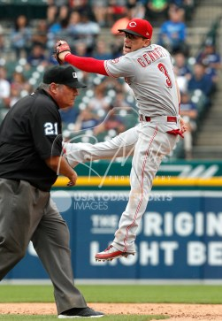 Aug 1, 2018; Detroit, MI, USA; Cincinnati Reds second baseman Scooter Gennett (3) jumps to reach the ball but misses during the sixth inning against the Detroit Tigers at Comerica Park. Mandatory Credit: Raj Mehta-USA TODAY Sports