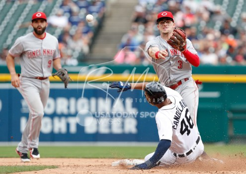 Aug 1, 2018; Detroit, MI, USA; Cincinnati Reds second baseman Scooter Gennett (3) gets the out at second base as he throws to first base against Detroit Tigers third baseman Jeimer Candelario (46) during the seventh inning at Comerica Park. Mandatory Credit: Raj Mehta-USA TODAY Sports