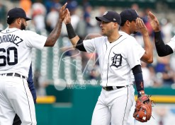 Aug 1, 2018; Detroit, MI, USA; Detroit Tigers shortstop Jose Iglesias (1) celebrates with third baseman Ronny Rodriguez (60) after the game against the Cincinnati Reds at Comerica Park. Mandatory Credit: Raj Mehta-USA TODAY Sports