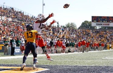 Sep 15, 2018; Toledo, OH, USA; Miami Hurricanes wide receiver Lawrence Cager (18) makes a catch for a touchdown against Toledo Rockets cornerback Ka'dar Hollman (13) during the third quarter at Glass Bowl. Mandatory Credit: Raj Mehta-USA TODAY Sports