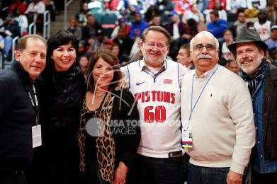 Dec 1, 2018; Detroit, MI, USA; Michigan senator Gary Peters (60) poses with wife Colleen Ochoa, vice chairman Arn Tellem (left) Ethan Davidson (right) and Mike Abdenour (Pistons former trainer) during the fourth quarter at Little Caesars Arena. Mandatory Credit: Raj Mehta-USA TODAY Sports