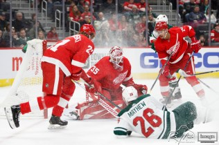 Feb 27, 2020; Detroit, Michigan, USA; Detroit Red Wings goaltender Jimmy Howard (35) makes a save against Minnesota Wild center Gerald Mayhew (26) during the first period at Little Caesars Arena. Mandatory Credit: Raj Mehta-USA TODAY Sports