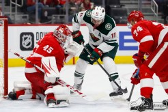 Feb 27, 2020; Detroit, Michigan, USA; Detroit Red Wings goaltender Jonathan Bernier (45) makes a save against Minnesota Wild left wing Zach Parise (11) during the third period at Little Caesars Arena. Mandatory Credit: Raj Mehta-USA TODAY Sports