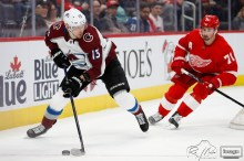 Mar 2, 2020; Detroit, Michigan, USA; Colorado Avalanche right wing Valeri Nichushkin (13) looks for an open man against Detroit Red Wings center Dylan Larkin (71) during the first period at Little Caesars Arena. Mandatory Credit: Raj Mehta-USA TODAY Sports